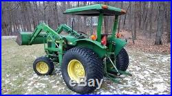 1986 John Deere 1050, MFWD, gear shift, loaded turf tires, Model 75 loader