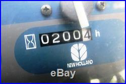 2006 NEW HOLLAND TZ25DA COMPACT TRACTOR With LOADER & BELLY MOWER. GOOD MACHINE