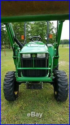 2013 John Deere four-wheel drive 32hp compact loader tractor. FREE DELIVERY