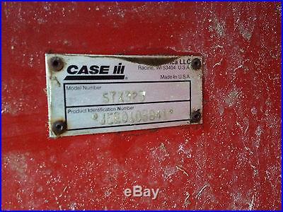 Case IH STX325 with 7900 Degelman Blade