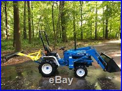 Ford New Holland 1220 tractor with loader and attachments LOW HOURS