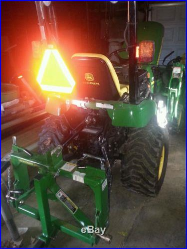 JD tractor 2305 2011 includes all attachments see description