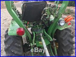 John Deere 650 4X4 bucket loader, rack and blade