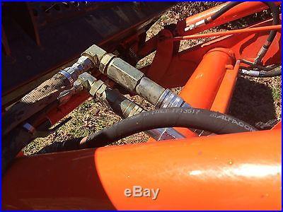 Kubota M-59 Backhoe/loader