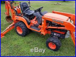 Kubota bx23 tractor with loader backhoe and front mount snowblower
