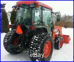 Kubota tractor 4x4 with cab, loader, and low hours