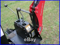 Mahindra eMax 22 Tractor with loader, backhoe and grader blade, 4 WD