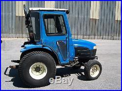 New Holland TC25D 4 wheel drive diesel tractor with cab and heat