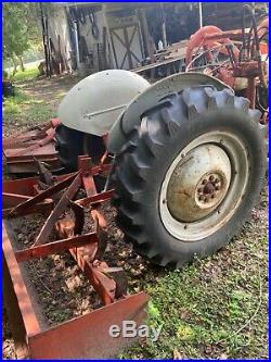Tractor with loader and trailer